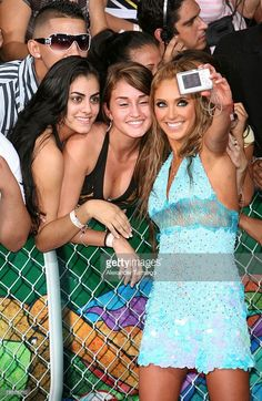 Anahi Giovanna Puente (R) of the band RBD poses with fans at the Bank United Center for the Premios Juventud Awards on July 19, 2007 in Coral Gables, Florida.