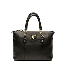 """Tommy Hilfiger women's handbag. Our genius convertible tote—convenient over the shoulder or demure carried by the handle. nbsp;nbsp;br/• Tote silhouette in leather.br/• Zip top, front sleeve, center zip compartment, interior pockets, gold tone hardware, adjustable shoulder strap.br/• 13"""" (L) x 4-1-2"""" (W) x 9"""" (H), adjustable strap.br/• Imported.br/"""