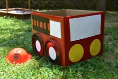DIY firetruck from a box for Logan's half of the b-day party.