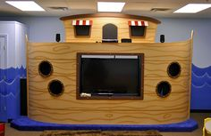 """Kids' """"Noah's Ark"""" puppet stage and media center for church room. www.ImaginationAtmospheres.com"""