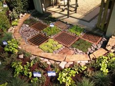 "This half-circle garden floor treatment by Courtney Goetz shows how to pair salvaged metal grates with colorful groundcovers to create a ""welcome mat"" at the entry to a garden shelter."