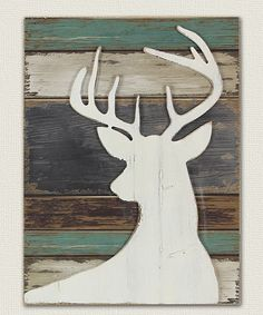 Add rustic charm to your décor with this wilderness-inspired wall sign.