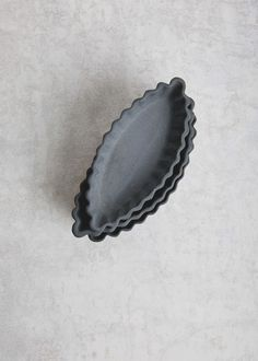 Image of fluted navette dish in charcoal