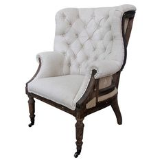 Wood-framed wingback arm chair with nailhead-trimmed tufted white linen upholstery castered feet.  $740.95 Product: ChairC...