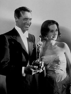 """""""Academy Awards: 30th Annual,"""" Cary Grant and Jean Simmons. 1958. Photo by Sid Avery"""
