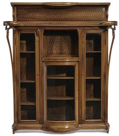 A Louis Majorelle glazed carved walnut vitrine cabinet circa 1903