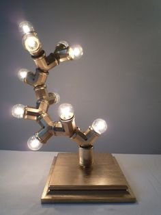 Legolas  table lamp Gold w/ clear bulbs by TheLightStore on Etsy, $218.00