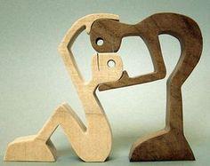 sculpture bois chantourné un homme un chien