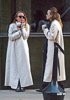 Mary-Kate and Ashley Olsen show two takes on a neutral maxi coat. #fall #winter #style #fashion #Olsentwins