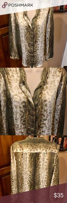 😳MICHAEL KORS SNAKESKIN PRINT TOP WITH GOLD CHAIN ABSOLUTELY STUNNING BUTTON DOWN BLOUSE WITH A GOLD CHAIN INTERTWINED THROUGH THE NECKLINE. SO CLASSY! WOULD LOOK GREAT WITH WHITEOR BLACK PANTS/JEANS/LEGGINGS OR DENIM JEANS OR A PENCIL SKIRT! 😍 I MAY HAVE WORN IT ONE TIME IF AT ALL. EXCELLENT CONDITION Michael Kors Tops Button Down Shirts