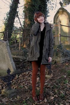 The Clothes Horse: green field jacket, black dress, burnt orange tights and matching shoes.