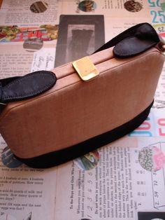 vintage silk handbag with black velvet trim. $12.00, via Etsy.
