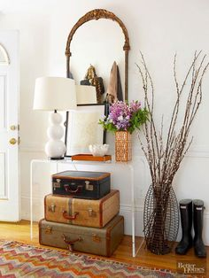 Stacking up vintage suitcases serve a practical purpose and make a pretty display.