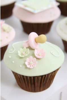 Pacifier Cupcakes, perfect shower treat. Change color of extras if you know what you're having.