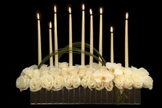 The candles and mirrored vase make me think this would be beautiful in a gothic castle