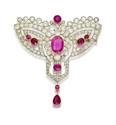 A belle époque diamond and ruby brooch, circa 1895  of openwork and stylized design, centering an oval-shaped ruby within a surround of old European-cut diamonds and accentuated by further oval-shaped rubies and pear-shaped ruby terminal; estimated total diamond weight: 16.70 carats; estimated total ruby weight: 9.70 carats; mounted in platinum topped eighteen karat gold