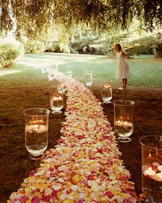 Fall Wedding Bride And Groom Entrance Rose Petals Candles Isles Red