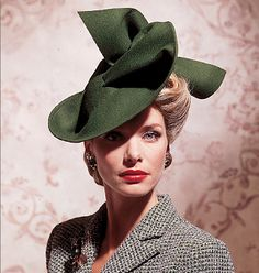1940s fashion. I feel as if this would be the fascinator I would wear if ever I wore one.