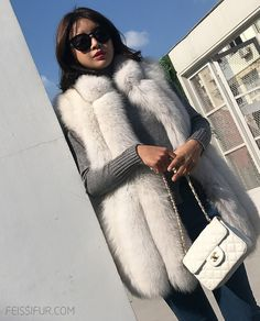Fox fur vest, comes in vertical stripped Blue Fox fur from SAGA, minimal design with long line slim cut offers a smooth and simple silhouette. Fox Fur Vest, Fur Jacket, Fur Vests, Fur Accessories, Furry Girls, Japanese Beauty, Fur Fashion, Asian Woman, Foxes