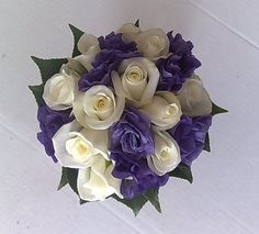 my wedding bouquet will look something like this, white roses and purple lisianthus