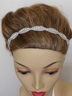 OK I'm officially in LOVE: This site is amazing for beautiful vintage jewelry accents!!! This high sparkle crystal rhinestone and beaded headpiece is perfect for my wedding. Made of Austrian Crystal of different sizes and handsewn in place with glass silver lined beading. Available in ivory and white. Ordering this one now.