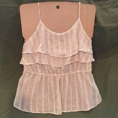 hello summer XXI small sheer cream tank Sheer tank from XXI in a cream/gold hue. Pretty shimmery accent strips throughout. Great piece to add to your spring and summer closet. XXI Tops Tank Tops