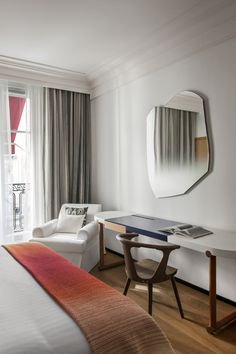 The Refurbished Hôtel Vernet in Paris by François Champsaur  Love the shape of the mirror