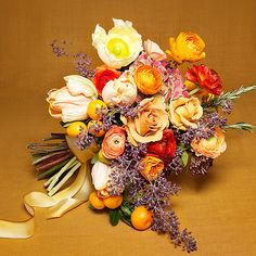 Brides.com: . Wedding Bouquet by Theme: Tuscan. A warm arrangement of poppies, parrot tulips, roses, ranunculus, hydrangeas, seeded eucalyptus, rosemary, and oranges.  Browse more bouquets for a rustic wedding.