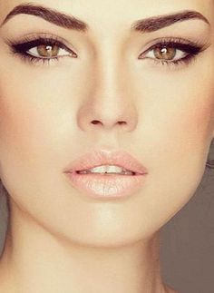Sculpted brows, a feline eye and long fluttery lashes create a strong, gorgeous look.