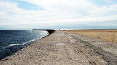 divisão entre céu, mar e areia