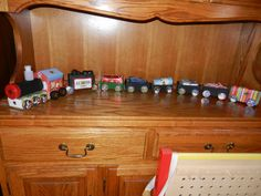 A train Advent Calendar -- used matchboxes, spice container, Altoids, and those small cereal boxes for cars. Glued on chocolate candy for wheels. I'll pin close ups of each car.
