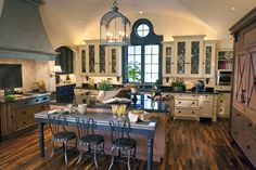 """Fabulous Kitchen set up and colors. I like the """"furniture"""" style legs on the cabinets"""