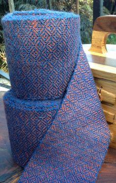 Hand woven broken diamond twill leg wraps in blue and orange from www.amagyarjurta.com.
