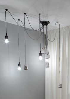 This 180 square meter home, designed and realized by FORM architectural bureau, combines a number cheerful natural materials in contrast to perfectly modern tex How To Make A Chandelier, Chandelier For Sale, Outdoor Chandelier, Modern Chandelier, Lighting Sale, Lighting Design, Pendant Lighting, Balloon Chandelier, Living Room Candles