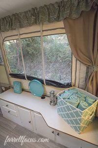 1996 Rockwood Pop Up PUP Tent Trailer RV remodel redo DIY. Light Blue and Green with grey plank flooring cushion covers bunting banners