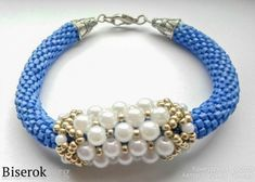 Irina Popova shows how to make a focal coat around a bracelet with embellished RAW.   (Must Translate) but the real value is in the concept.  #Seed #Bead #Tutorials
