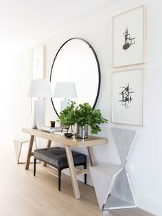 The entryway was left white and welcoming, with hardwood floors that mimic the light wood used in the custom-made table. Graphic whitewashed teak chairs by Maximilian Eicke provide an element of whimsy and are offset by a custom-made bench upholstered in a playful Rogers and Goffigon mohair.