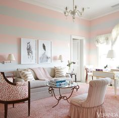 pink and gray striped walls, horse photography, pink carpet, and a mirrored table // living rooms
