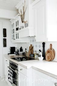 I like the exhaust Hood over stove. Paint can simplify and unify disparate style elements and materials.