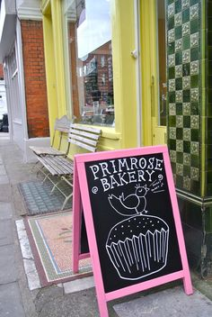Chalkboard sign with pink frame at Primrose Bakery in London