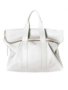 3.1 Phillip Lim 31 Hour Bag | Structured silhouette in polished bright white | Silver hardware | Two-way zip, fold-over top | Tubular top handles | Inside zip pocket | Lined | Duster bag included 100% Leather