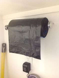 Smart! Paper towel holder for trash bags on a roll....