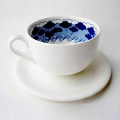 Storm in a Teacup.       A Large, elegant and high quality white china teacup and saucer, with a dark blue image of a ship in a storm printed inside the cup. (Can you spot the whale)    Illustrated in a modern delft style, the image creates a visual play on a well-known analogy.