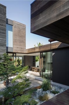 Seattle architecture firm MW Works has helped a couple build this home, which is organised around a courtyard and clad in weathered reclaimed timber.