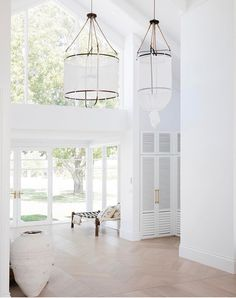 """Glass entrance to """"Bonnie's Dream House"""" with integrated mud room behind slatted doors on right 