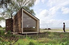 eco-friendly portable log house. So easy. Would need a protective layer inside though..for practical reasons of security.