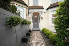 Gorgeous Edwardian family home, North London, black and white tiled path - Modern Bay Trees In Pots, Potted Trees, Topiary Trees, D House, House Front, Bay Tree Front Door, Front Doors, Edwardian Haus, Edwardian Hallway