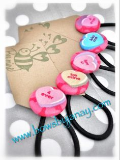 Valentine favors. Button ponytail holders. $2 each. www.bowsbyjanay.com