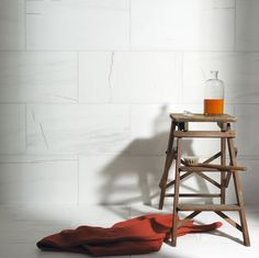 St Moritz Vein Polished Marble Tiles | From Mandarin Stone | www.mandarinstone.com | A striking dolomitic marble of pure white scattered with some grey and burnt orange movement/veining | Beautiful!