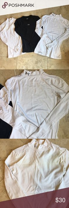 Under Armour Athletic Long Sleeve Bundle all are size small, both white ones are in excellent condition while the black one shows some pilling on the sides and sleeves. white ones are both cold gear. the one on the left is a women's small while the right is a men's small. black is a much thinner, dry fit material Under Armour Tops Tees - Long Sleeve
